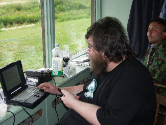 Jon inputs data into his laptop at the expedition base