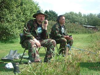 Richard and John Fuller survey the lake